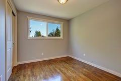 Simplistic hardwood bedroom. Stock Photos