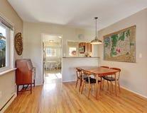 Simplistic hardwood dining room. Royalty Free Stock Photo
