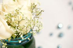 Simplistic and Rustic Blue and White Flower Table Arrangement - Wedding/Event Decor. This is a rustic and simplistic wedding detail that speaks to a blue and Royalty Free Stock Photos