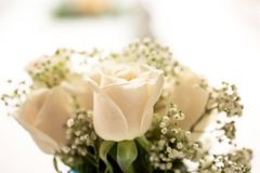 Simplistic and Rustic White Table Arrangement - Wedding/Event Decor. Wedding details that speak to the theme of true love. This is a rustic and simplistic Royalty Free Stock Images