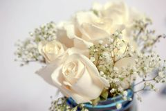 Simplistic White and Blue Flower Arrangement. Simplistic flower detail for wedding or event tables: Simplicity is trending with weddings and events. This image Stock Images