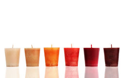 Simply candles. Colorful candles in a row Stock Photos