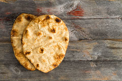 Simply delicious baked naan flatbreads on Picnic Table Stock Images