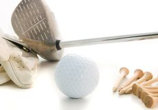 Simply Golf. A few golf essentials, glove tees driver. All served up on a nice white table Royalty Free Stock Images