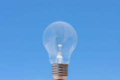 Simply light bulb in blue sky Stock Images