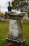 Simply mother. Ancient beautifully carved tombstone, fall season Stock Photography