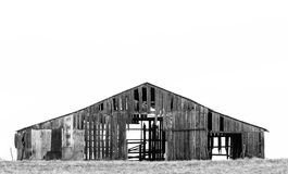 Simply Rotting Barn. Black and white photo of an old abandoned and rotting barn in a psture Stock Images