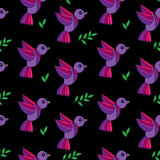 Simply seamless pattern with colorful birds and green leaves on Royalty Free Stock Photos