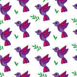 Simply seamless pattern with colorful birds and green leaves  Royalty Free Stock Images