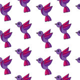 Simply seamless pattern with colorful birds on the white backgro Royalty Free Stock Image