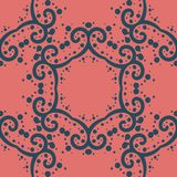 Simply symmetrical pattern on coral color stock image