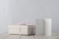 Simply Wrapped Gift Box with Icy Pink Raffia bow tie and Greetin Stock Photos