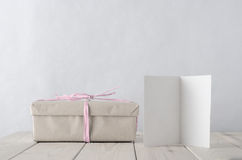 Simply Wrapped Gift Box with Icy Pink Raffia tie and Greeting Ca Royalty Free Stock Photo