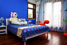 Simplyfurnished room with a boy child characteristics Stock Photography