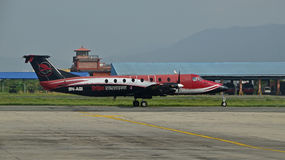 Simrik Airlines at Nepal Tribhuvan International Airport. This is a Beechcraft 1900 with 19 passenger seat,  pressurized twin-engine turboprop fixed-wing Stock Images