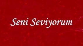 Simsen Sie ich liebe dich auf Türkisch Seni Seviyorum, das vom Staub und von den Drehungen gebildet wird, um horizontal auf rotem stock abbildung