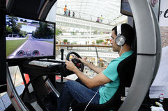 Simulador de condução moderno para a academia da GT Imagens de Stock Royalty Free