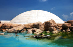 Simulated ice-house. Among rocks and water royalty free stock image