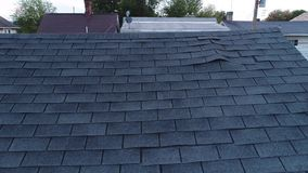 Video Feed of Roof Inspector and Damaged Shingles on Roof stock video