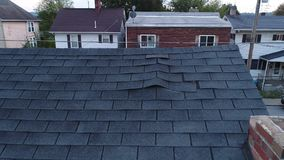 Video Feed of Drone Inspecting Damaged Shingles on Roof stock video footage