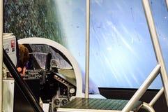 Simulateur de vol de combattant présenté sur la foire d'air Image stock
