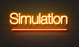 Simulation neon sign on brick wall background. Stock Photos