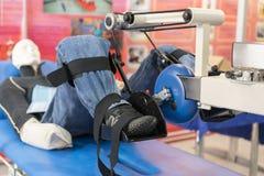 Simulator for leg rehabilitation. rehabilitation of injured limbs. Mannequin in the apparatus for training legs. Simulator for leg rehabilitation royalty free stock photo