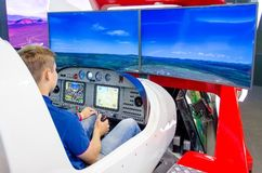 Simulator of a passenger aircraft with a cockpit and pilots. Stock Photo