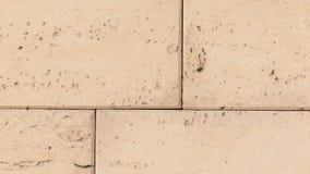Simulierte Sandsteinblöcke im Beton Stockbild