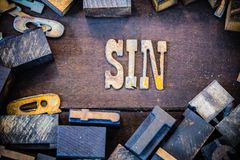 Sin Concept Rusty Type Stock Image