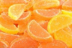 Sinaasappel en citroen de suikergoedplakken sluiten omhoog Stock Afbeelding