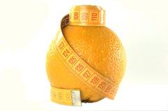 Sinaasappel en de kleermakers- meter Stock Fotografie