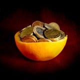 Sinaasappel en geld Royalty-vrije Stock Foto