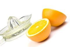 Sinaasappel en juicer Royalty-vrije Stock Foto