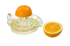 Sinaasappel en juicer Stock Afbeelding