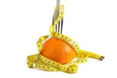 Sinaasappel en vork Stock Foto's