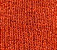 Sinaasappel gebreide sjaaltextuur Stock Afbeeldingen