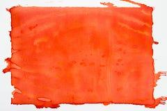 Sinaasappel geschilderde waterverftextuur als achtergrond stock fotografie