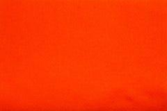 Sinaasappel gevoelde weefseldoek, de achtergrond van de close-uptextuur Stock Afbeeldingen