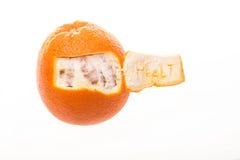Sinaasappel met etiketgezondheid. Stock Afbeelding