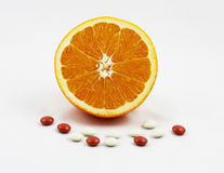 Sinaasappel met Vitaminen en Mineralen Stock Afbeeldingen