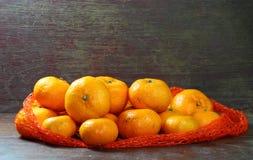 Sinaasappel op Hout Stock Fotografie
