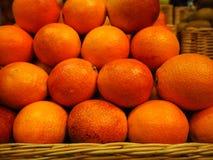 Sinaasappelen in de opslag stock foto