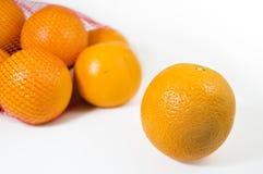 Sinaasappelen die op wit worden geïsoleerdv Royalty-vrije Stock Afbeelding