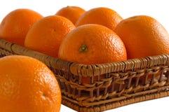 Sinaasappelen in een voederbak Stock Afbeeldingen