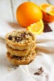 Sinaasappelen en chocoladetaartjes Stock Foto's