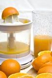 Sinaasappelen en mixer royalty-vrije stock foto's