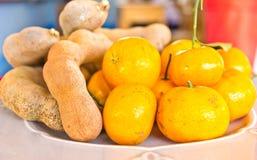 Sinaasappelen en tamarindes Stock Foto's