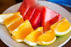 Sinaasappelen en watermeloen Stock Afbeelding