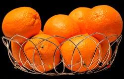 Sinaasappelen in mand Stock Foto
